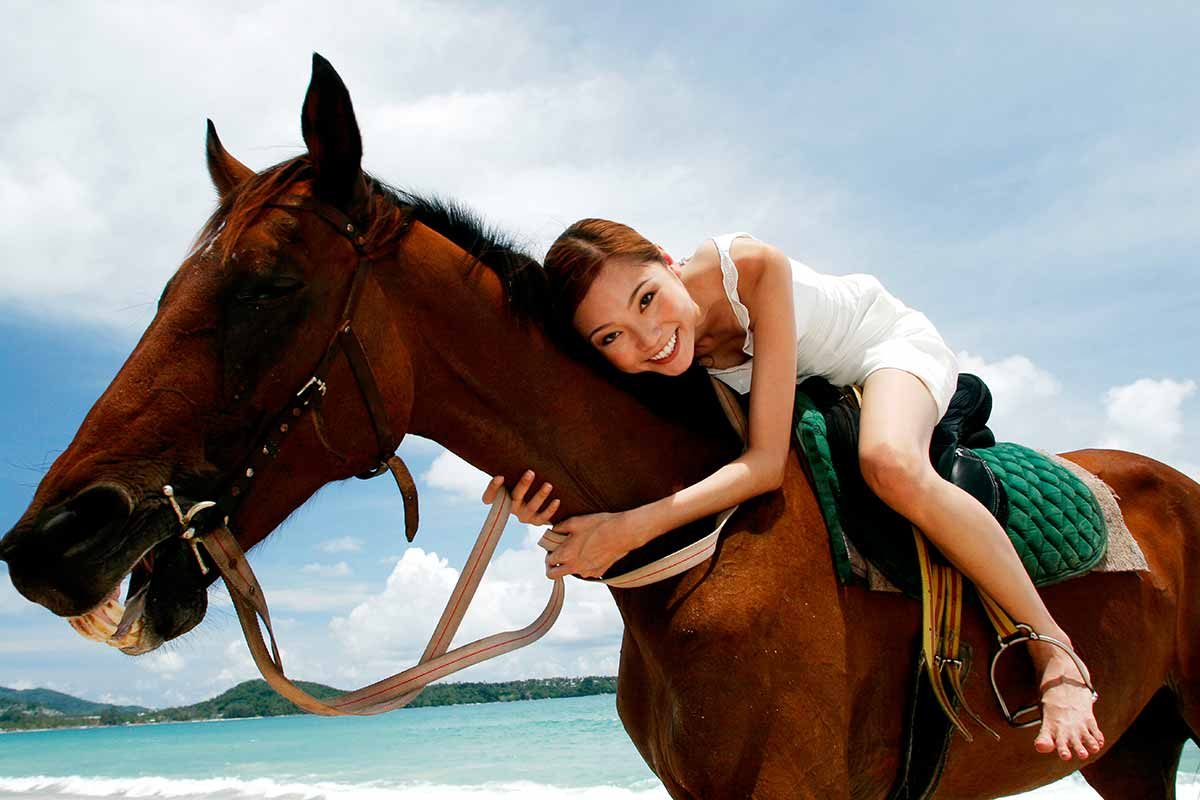 Girl Hugging A Quarter Horse