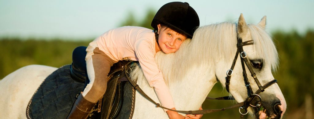 Young Girl Hugging Horse